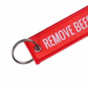 Schlüsselanhänger remove befor flight Detailfoto
